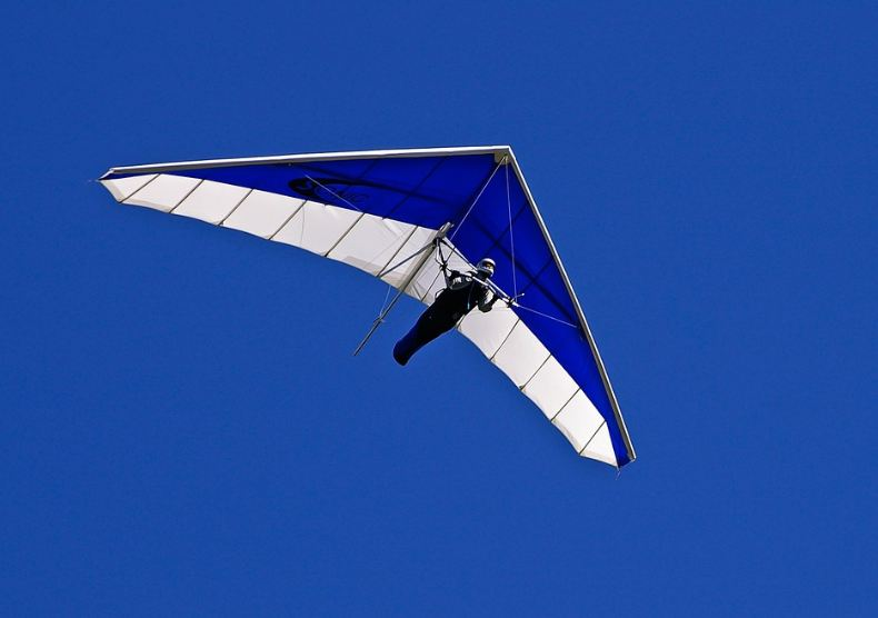 a blue and white hang glider
