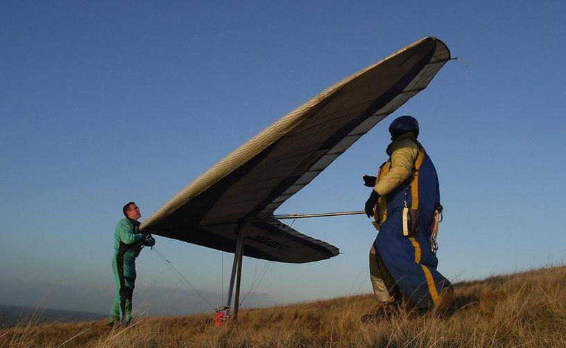 people getting ready for hang gliding